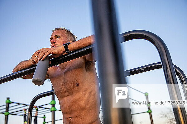 Spain  Mallorca  Man resting after workout at outdoor gym