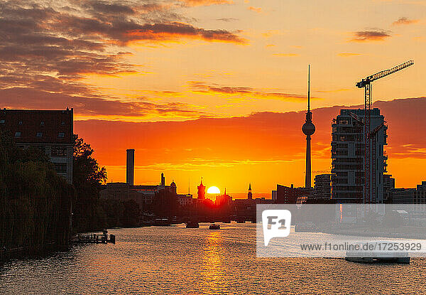 View of boats sailing in River Spree and city during sunset  Berlin