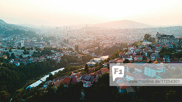 Aerial view of Sarajevo cityscape during sunrise