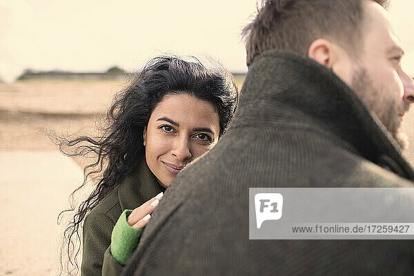 Portrait beautiful woman with husband on beach