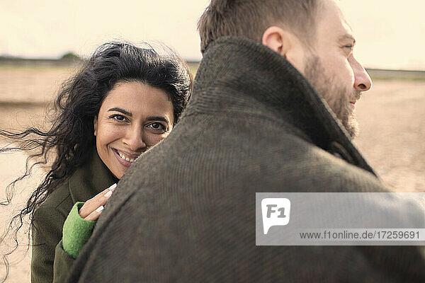 Portrait happy affectionate couple in winter coats