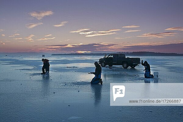 Ice Fishing  at Sand Bar  on frozen  Lack Champlain  Milton  Verrmont  USA  North America