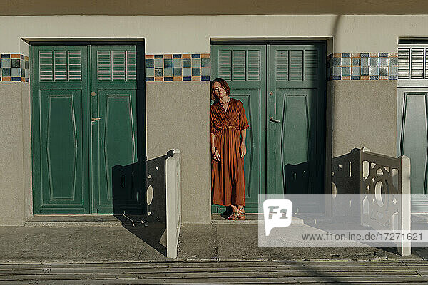 Woman leaning on door in resort at Deauville  France