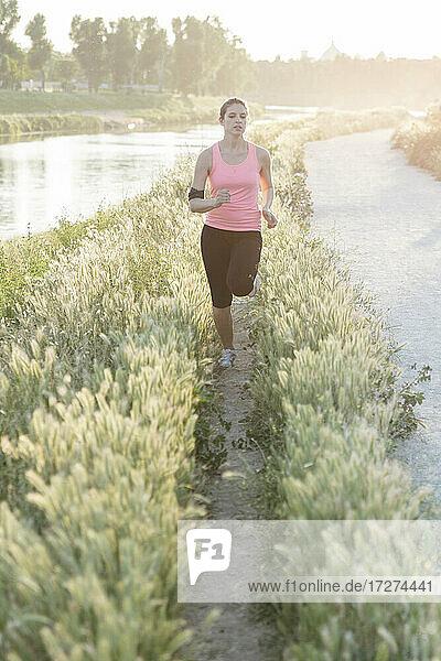 Fit female athlete jogging in park