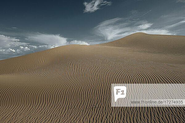Cadiz dune against against sky at Mojave desert  Southern California  USA