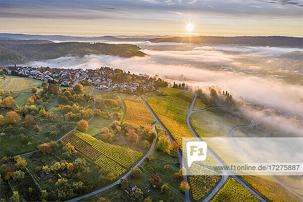 Germany  Baden Wurttemberg  Remstal  Drone view of countryside town at foggy sunrise Germany, Baden Wurttemberg, Remstal, Drone view of countryside town at foggy sunrise
