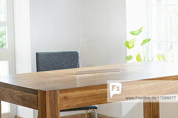 Futuristic device screen on desk in office
