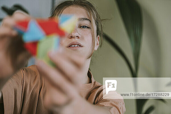 Teenage girl playing with puzzle at home