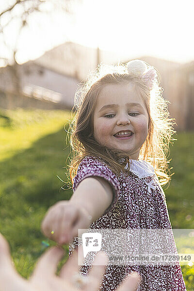 Smiling girl enjoying weekend with father in springtime
