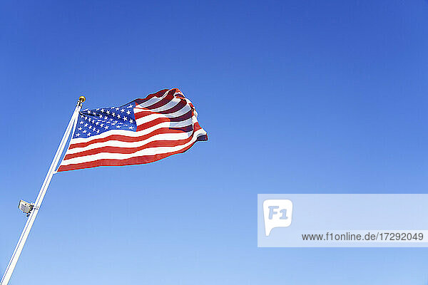 American flag waving during sunny day