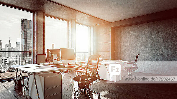 Interior of office with sunlight streaming through window