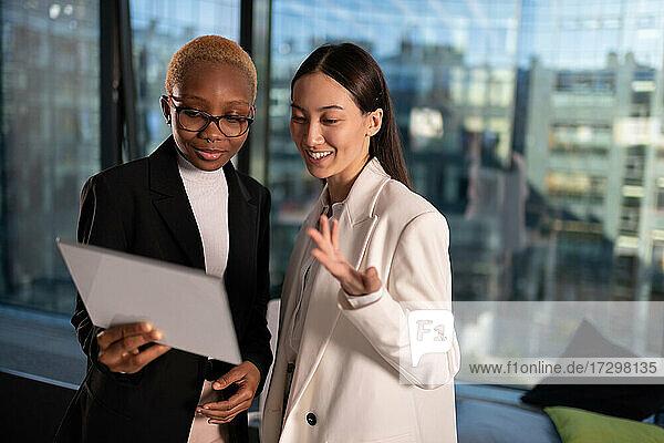 Multiracial businesswomen making video call