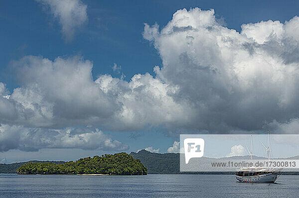 sail boat anchored at small island in Raja Ampat / Indonesia