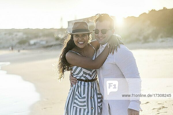 Young couple enjoying time together on the beach in Algarve  Portugal  Europe