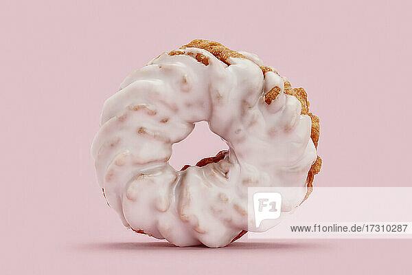 Close up gefrostet rosa Cruller Donut