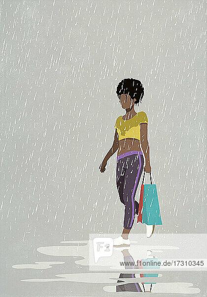 Frau mit Einkaufstasche zu Fuß in regen