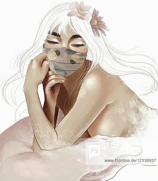 Schöne junge Frau mit Gesichtsmaske