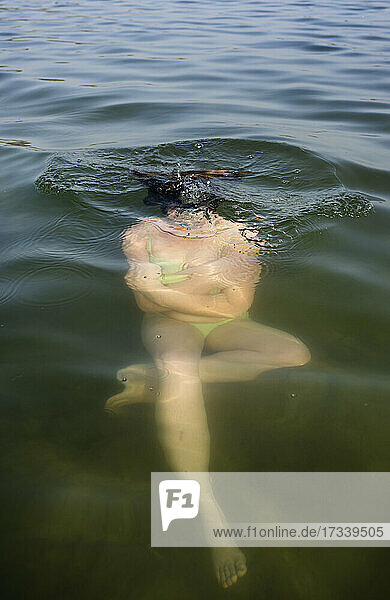 Netherlands  Noord-Brabant  Breda  Woman submerging in lake