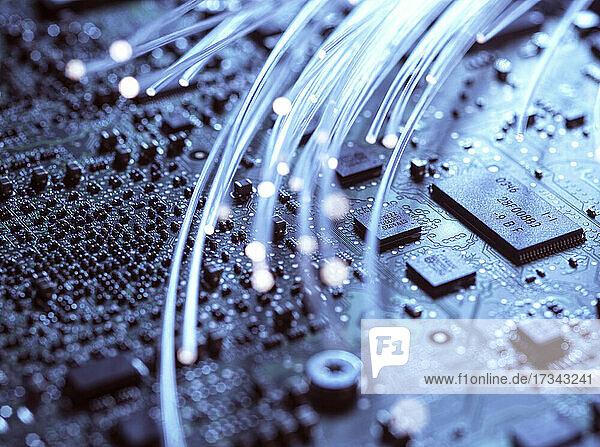 Close-up of fibre optics and computer circuit board