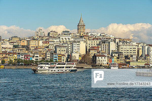 Turkey  Istanbul  Tourboat in Golden Horn waterway and Karakoy neighborhood