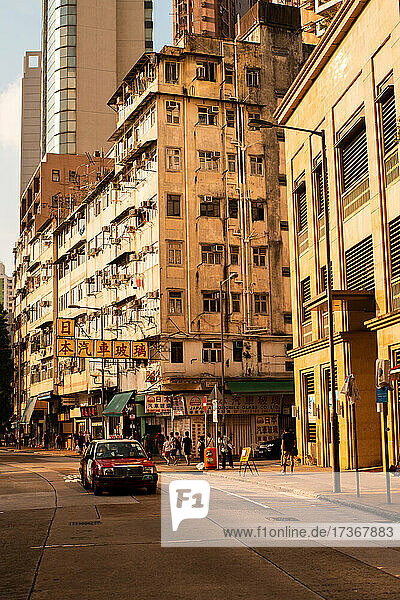 View of residential buildings with car moving on street  Hong Kong View of residential buildings with car moving on street, Hong Kong