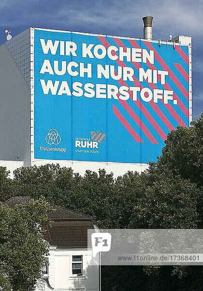 Large poster on the A 40 motorway  climate steel at the ThyssenKrupp Steel Bochum plant  Ruhr area  North Rhine-Westphalia  Germany  Europe Large poster on the A 40 motorway, climate steel at the ThyssenKrupp Steel Bochum plant, Ruhr area, North Rhine-Westphalia, Germany, Europe