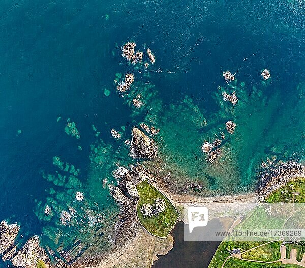 Top view  drone shot  of the granite coast of Plougrescant overlooking the Atlantic Ocean and the house among the rocks (Le gouffre de Plougrescant)  Côtes-d'Armor department  Brittany  France  Europe Top view, drone shot, of the granite coast of Plougrescant overlooking the Atlantic Ocean and the house among the rocks (Le gouffre de Plougrescant), Côtes-d'Armor department, Brittany, France, Europe