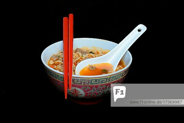 Asian noodle soup in bowl with Asian spoon and chopsticks  Germany  Europe Asian noodle soup in bowl with Asian spoon and chopsticks, Germany, Europe