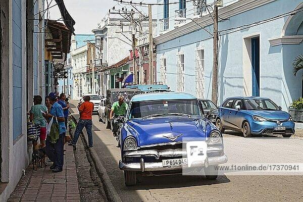 Street Scene  Caribbean  People  Cubans  Road Traffic  Front Vintage Plymouth Belvedere 1955  Sancti Spiritus  Central Cuba  Sancti Spiritus Province  Cuba  Central America