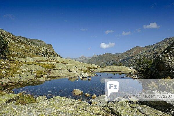 Small lake on the Petit train d'Artouste  above the valley Vallee du Soussoueou  Vallee d'Ossau  Haut Ossau  Laruns  Central Pyrenees  Main Pyrenean Ridge  Pyrénées-Atlantiques department. Region Nouvelle-Aquitaine  France  Europe