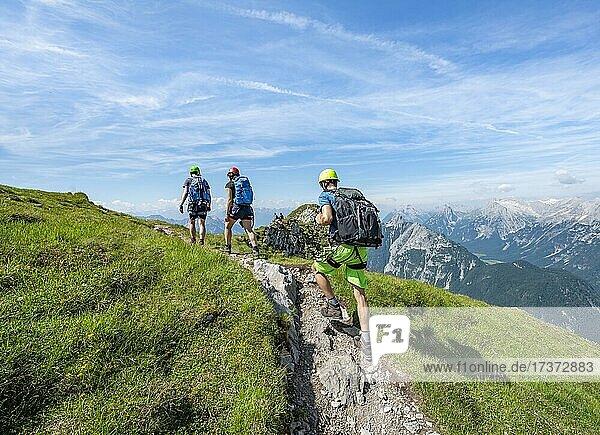 Mountaineers hiking on the via ferrata Mittenwalder Höhenweg  Karwendel Mountains  Mittenwald  Bavaria  Germany  Europe