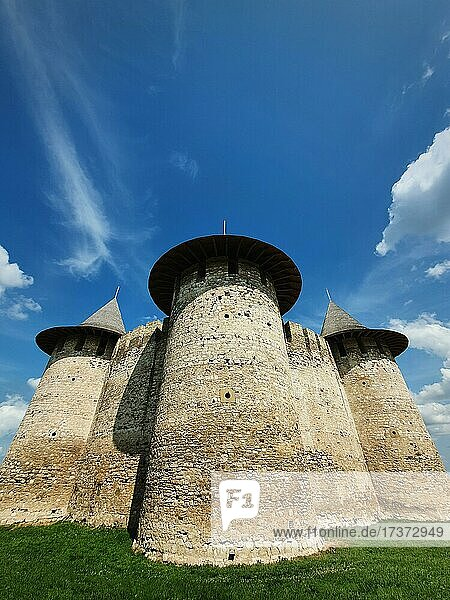 Soroca Fortress view from outside. Ancient military fort  historical landmark located in Soroca city  Moldova. Outdoors facade  old stone walls fortifications  towers and bastions of medieval citadel