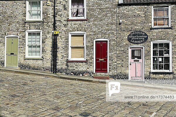 Street with cobblestones and old dwellings on the hillside  colourful doors  Steep Hill  Lincoln  Lincolnshire  East Midlands  England  United Kingdom  Europe