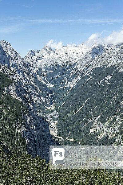 View into the Reintal valley  behind summit of the Zugspitze with Zugspitzplatt  hiking trail to the Meilerhütte  Wetterstein Mountains  Garmisch Partenkirchen  Bavaria  Germany  Europe