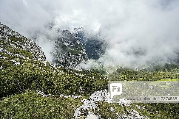 View of the cloud-covered Reintal valley and the peaks of the Wetterstein mountains  hiking trail to the Meilerhütte  Wetterstein mountains  Garmisch Partenkirchen  Bavaria  Germany  Europe