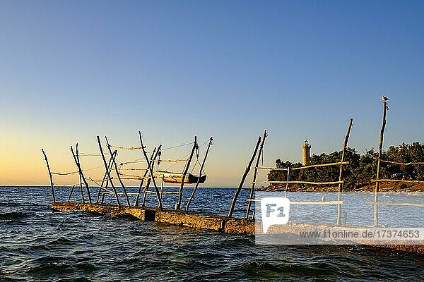 Wooden rack for hanging boats  in the back the lighthouse of Savudrija  Adriatic Sea  Istria  Croatia  Europe