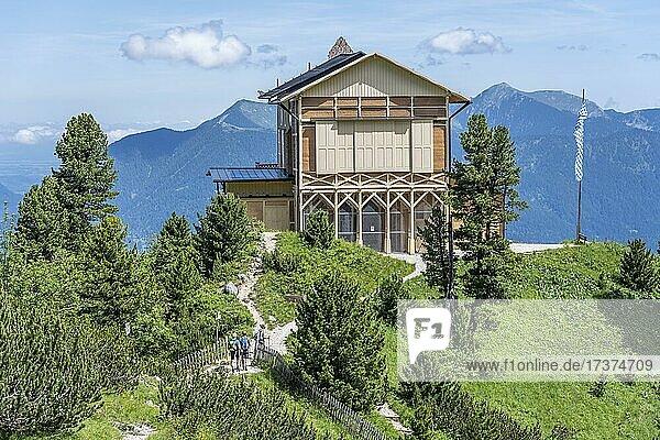 Schachenhaus with mountain panorama  Schachenschloss  Königshaus am Schachen  hikers on a hiking trail  Wetterstein Mountains  Garmisch Partenkirchen  Bavaria  Germany  Europe