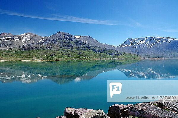 Mountains reflected in the fjord  tranquil landscape  Igaliku  Narsaq district  Greenland  Denmark  North America