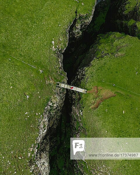 Aerial view  a person standing on a small wooden bridge  Sandvik  Suduroy  Faroe Islands  Europe