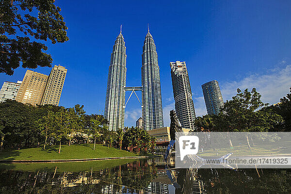 Malaysia  Kuala Lumpur  Pond and whale sculpture in KLCC Park with Petronas Towers in background