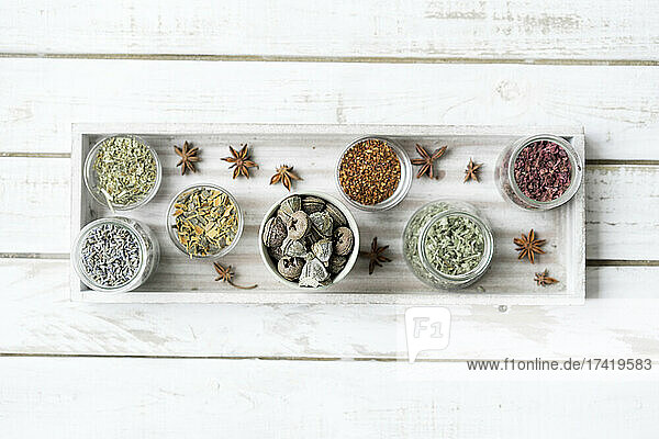 Spices and herbs arranged in serving tray over table