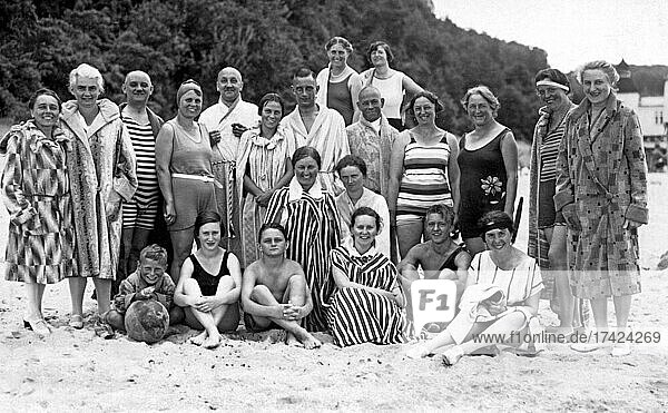 Group with bathers at the beach  funny  laughing  summer holidays  holiday  joie de vivre  about 1930s  Baltic Sea  Usedom  Mecklenburg-Western Pomerania  Germany  Europe