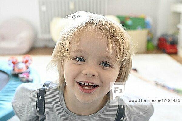 Little blond boy  4 years  portrait  children's room  Baden-Württemberg  Germany  Europe