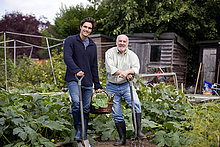 A father and his son working on an allotment together