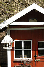 Birdhouse at red garden shed