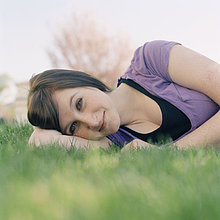 A young woman lying in the grass