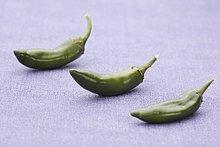 Drei grüne Chilischoten
