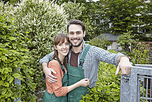 Germany, Cologne, Portrait of young couple embracing each other, smiling