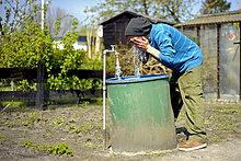 Man washing himself in the garden